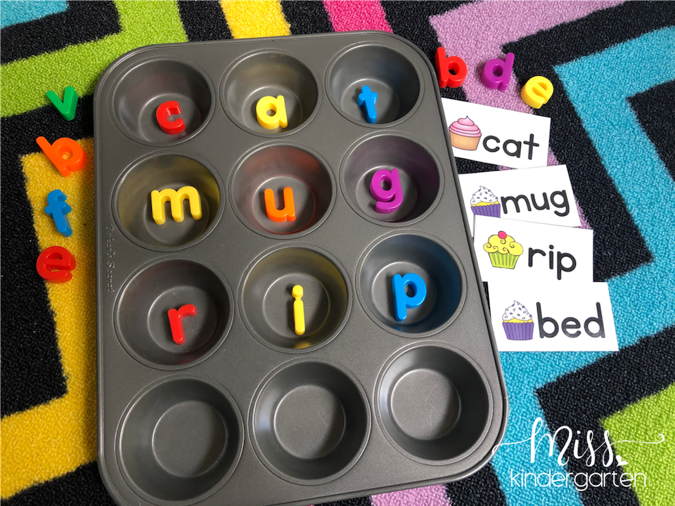 A picture of a muffin tin with magnet letters inside the each circle to spell a CVC word.