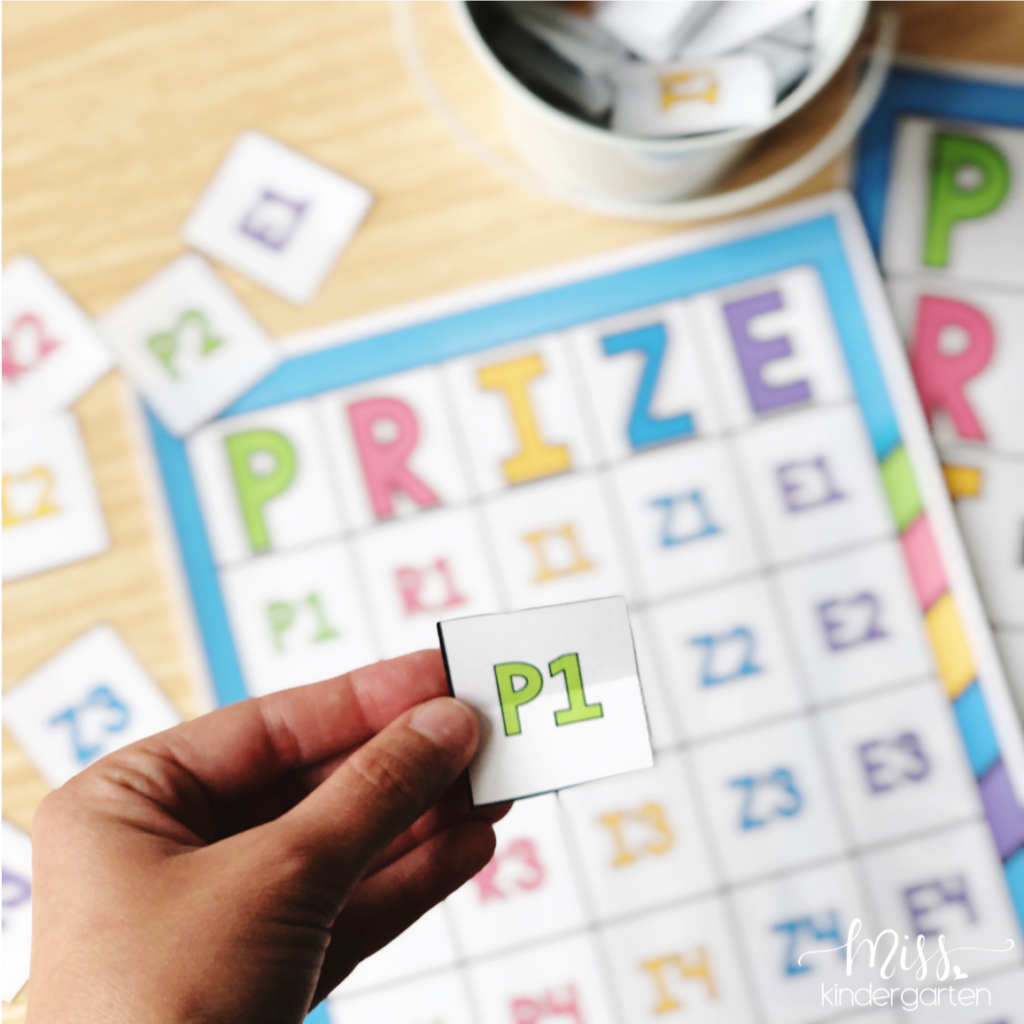 choosing a ticket to go on our behavior bingo board